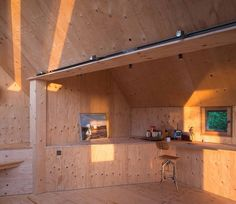 Inexpensive yet warm, plywood can be used in excess to create a minimal-yet-inviting interiors.