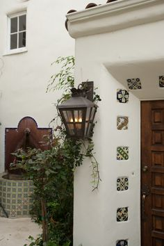 Wrought iron outdoor lighting for a charming tuscan style home love mediterranean style home inspiration the wrought iron lantern and tile work are the perfect finishing mozeypictures Choice Image