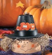 Big Tuna or Chicken can and a clay pot and moss and craft foam and some paint and there ya got a witch!