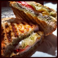 This panini was AMAZING! It's a trader joe's recipe: sour dough bread, pesto, havarti cheese, jar of roasted bell pepper, and turkey breast.