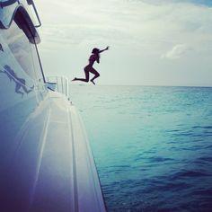 Loving life jumping into the water in Bimini Bahamas .
