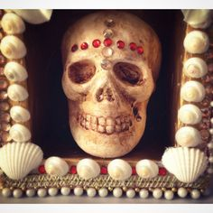 READY TO SHIP! Within 1-3 days! Saint Of Skulls  The Saint Of Skulls is a gothic decorative skull shrine inspired by Catholic Reliquaries and Saints from the Catacombs. At the centre of the shrine is a skull which has been aged with washes of paint. Set within a shadow box the skull sits inside against gold paint. The box is decorated with red fabric, flowers, trimmings, shells, rhinestones and pearls. This is an original mixed media decorative art piece. Some of the materials I use are…