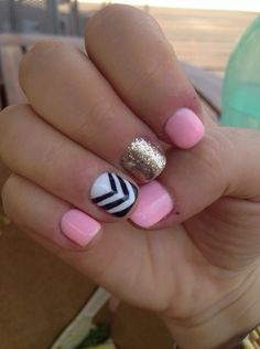 Pink, black and white triangle stripes and gold glitter to create the perfect set of nail art.