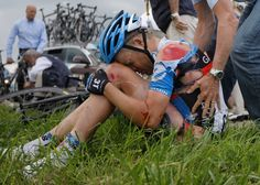 American Tom Danielson rests in the grass after the stage six crash on July 6, 2012. Already riding with a separated shoulder from a crash days earlier, Danielson was forced to abandon the race. He finished in the top ten in 2011. (Laurent Cipriani/Associated Press)