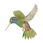 If I were a rich old lady, I would have a collection of jeweled brooches. This from Tiffany & Co. Hummingbird brooch with tsavorites and diamonds set in 18 karat yellow gold