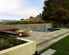 Exciting Idea to Build Above Ground Plunge Pool : Corner Bench Large Concrete Fire Bowl Small Square Above Ground Plunge Pool