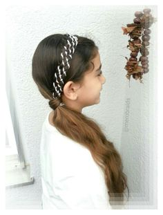 8 strand braid with ribbon into a side ponytail
