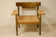Beech And Caned Chair in the Style of Magistretti | From a unique collection of antique and modern armchairs at https://www.1stdibs.com/furniture/seating/armchairs/