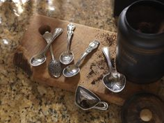 Left to right: Teaspoons: $16.  1. Matthew 22:37  2. Stir with love  3. Savor the Moments  4. Oh Sweet My Cup Overflows Coffee Scoop: $26 Mary & Martha Coffee Scoop: $28