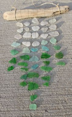 Sea Glass Wind Chime... I never collect rocks or shells at the beach cause they just end up being thrown away but next time I go to the beach I am TOTALY going to collect some sea glass!!