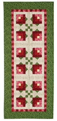 Careful fabric selection and color placement form these sweet little rosebuds. This free quilt pattern, Rosebud, was designed and made by Jen Daly and is made with easy blocks!