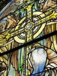 Righteous Shall Receive A Crown of Glory-- Louis Comfort Tiffany Window housed at the Corning Museum of Glass. This angle captures the stunning three dimensional glass gems in the cross.