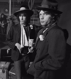 CARNATION.  SCARF? Keith Richards and Mick Jagger