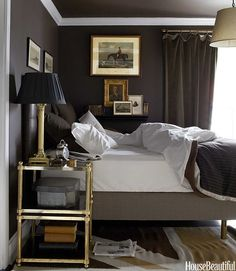 bedroom with black walls and gold accents