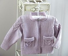 Childs Cardigan with cable detail on sleeves and pockets.