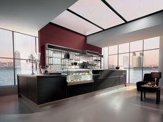 Banco bar Shanghai con struttura in vetro con doppia soluzione di altezza e con piani neutri, caldi o refrigerati. Banco bar marcato da pregiate texture.