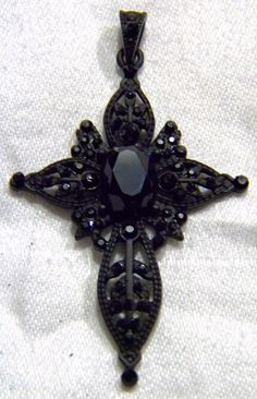 Vintage Dimensional Round  Oval Jet Black Rhinestone Fancy Filigree Art Deco Style Bold Cross Pendant Charm by NicosNostalgia on Etsy https://www.etsy.com/listing/113482699/vintage-dimensional-round-oval-jet-black