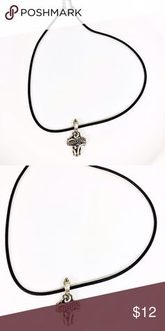 Silver Cross Necklace on Black Cord Silver cross necklace on a black cord. Great condition. Jewelry Necklaces