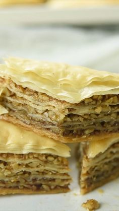 This Baklava recipe is a showstopper dessert. This Baklava recipe is a showstopper dessert and loved by all at gatherings. Layers of buttery phyllo dough stacked between a cinnamon walnut filling then finished with a honey glaze. A must at holiday time! Sweets Recipes, Easy Desserts, Baking Recipes, Cookie Recipes, Delicious Desserts, Yummy Food, Passover Desserts, Unique Desserts, Carmel Desserts
