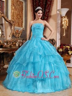 Impression Aqua Blue Quinceanera Dress Strapless Organza Beading Ball Gown  http://www.fashionos.com    A fresh and vibrant coral hue creates a springy feeling for this Quinceanera?princess?gown. Silver?embroidery?at the strapless bust panel has wispy designs, and the fabric gathers throughout the mid-section to shape a delicate waist curve. The layered ballroom skirt with a bit of silvery shimmer. You are sure to love it!