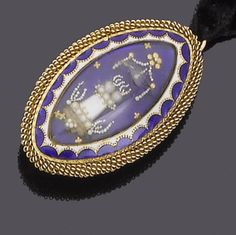 A gold, enamel and seed pearl brooch/pendant, circa 1790  The oval blue enamel ground overlaid with a mother-of-pearl and seed pearl smoking funeral pyre, beneath a glass cover, within a blue and white enamel border and a coiled gold surround, later brooch and pendant fittings, length 4.1cm., fitted case