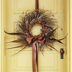Pheasant feathers add fall flair to any door. Start with a purchased twig wreath,wrap pussy willows and feathers around the twig base. Dress it up with a raffia or grosgrain ribbon bow.