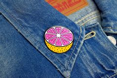 "It's back and bigger than ever! Our grapefruit brooch has doubled in size!!-1-1/2"" hard enamel pin-Gunmetal colored metal-2mm thick-Double posts with rubber pin"