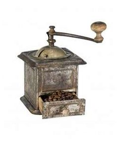 Antique coffee grinder filled with coffee beans