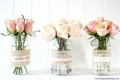 fresh flowers in a clear vase with ribbon rm
