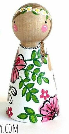 Peg doll with flowery dress.