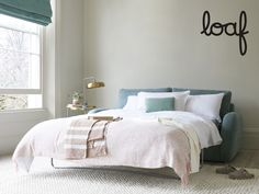 This laid-back lump of loveliness hides a comfy fold-out bed. Just remember that guests, like fish, go off after three days. White Bed Sheets, White Bedding, Pleated Curtains, Curtains With Blinds, Chaise Chair, Sofa Bed, Home Bedroom, Bedrooms, Fold Out Beds