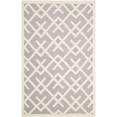 Moroccan inspired design and dense hand-woven wool pile highlight this handmade dhurrie rug. This floor rug has a grey background and displays stunning panel colors of ivory.