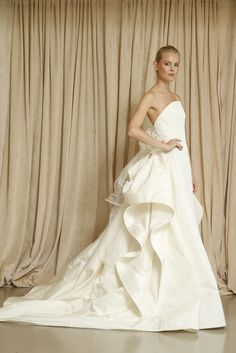 Oscar de la Renta 2014 - I LOVE the dramatic back paired with the elegant simple front! #pinkbowtie