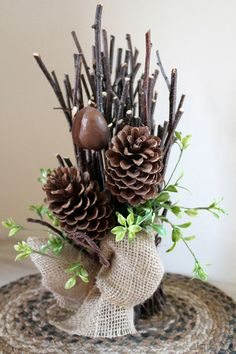 Everyone loves a popular autumn foliage theme, so bring the crisp coziness of fall indoors with a natural centerpiece of pinecones and birch