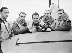 A group of pilots of No. 303 Polish Fighter Squadron RAF stand by the tail elevator of one of their Hawker Hurricane Mark Is at Northolt, Middlesex. They are (left to right): Pilot Officer Mirosław Ferić, Flying Officers Bogdan Grzeszczak, Pilot Officer Jan Zumbach, Flying Officer Zdzisław Henneberg and Flight-Lieutenant John Kent, who commanded 'A' Flight of the Squadron at this time. October 1940.