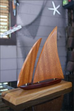 Wooden Sailboat - The jib (front sail) can swing back and forth allowing you to adjust how you want it to look when on your tabletop. Each piece of wood has its own unique appearance and varies slightly so each sailboat will be unique.  This makes a great gift for many occasions including Birthdays, Father's Day, 5 Year Anniversary, or for yourself. Sailboat Lovers, Sailboat Collectors, or Nautical Lovers of all ages will love it. http://woodsmithofnaples.com/wooden_sailboat_2.html
