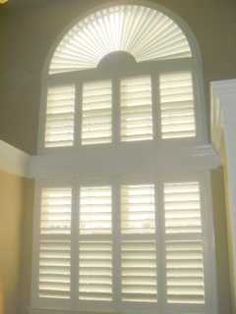 Louverwood Poly Shutterson Sunburst and rectangular window with our Perfect View option on large windows in a Bathroom.   www.louvershop.com