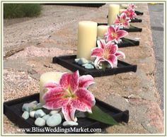 Stargazer Lily centerpieces from Weddings in Bliss!