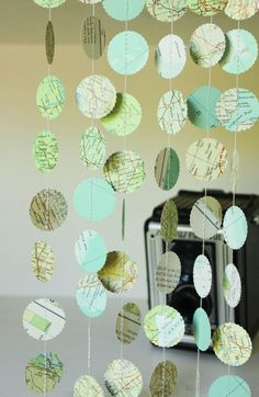 Vintage Paper Atlas Garlands, Map Page Garlands, Paper Party Decorations, Set of 3. $6.00, via Etsy.