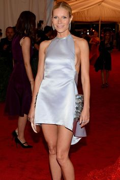 Gwyneth Paltrow shows off her lovely legs in a barely there, metallic Prada minidress.