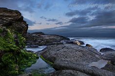 An Evening Storm Approaches in a Secluded Cove at Beavertail State Park in Jamestown Rhode Island, USA
