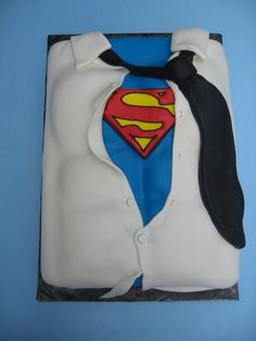 Superman Cake ...you know what I'm thinking... (But seriously, a man dressed as Superman at his party might be just plain ol' odd)