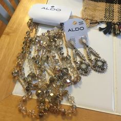 Aldo necklace and earring set A beautiful double layer necklace with crystals throughout. The earrings compliment the necklace with matching rhinestones and a soft feminine appearance. ALDO Jewelry Necklaces