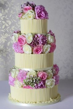 Classic White Chocolate Cigarello with English Garden Flowers - http://www.lepapillonpatisserie.com/wedding-cakes/vintage-cigarello-wedding-cake/#