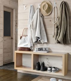 """A Modern Spin on Cabin Decorating Elements: Minimal mudroom/ hallway/ foyer design: """"A floating pine shelf offers a spot for bags, Foyer Design, Deco Design, House Design, Lobby Design, Design Design, Design Elements, Modern Cabin Decor, Modern Cabin Interior, Country Cabin Decor"""