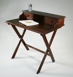 Wedding sustainability, convenience, portability, and a bit of history, Manchester Wood crafts their solid wood Campaign Desk out of timber from responsibly managed forests for those in need of a lightweight, movable workspace.