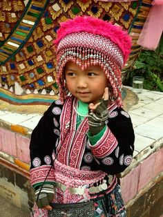 The girl is dressed in traditional Thai Hill Tribe clothing.