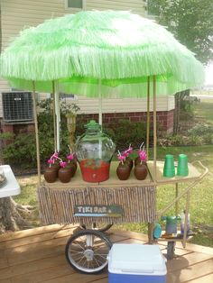 "I really like the idea maybe I could find a tall table and decorate it and use the little coconuts and have a tiki ""bar"""