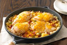In this twist on meat and potatoes, chicken breasts carry the day. Bacon adds flavor and Cheddar cheese melts on top for ooey-gooey goodness.