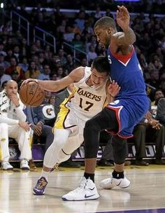 Philadelphia 76ers' Thomas Robinson, right, pressures Los Angeles Lakers' Jeremy Lin during the second half of an NBA basketball game, Sunday, March 22, 2015, in Los Angeles. The Lakers 101-87. (AP Photo/Jae C. Hong)